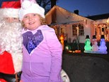 Honey Boo Boo perches on Santa 'Pumpkin' Claus' lap during the family's fourth annual Christmas toy drive