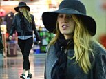 Hats off to her! Blake Lively shows off her unique jetsetting look in floppy headpiece and spats-style shoes