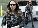 Keeping it under wraps: Pregnant Tamara Ecclestone covers up her baby bump once more in a tie-dye effect jumper