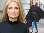 Working it: Kristin Chenoweth was spotted during a photo shoot on a New York City side walk, surrounded by onlookers as she worked a billowing black tunic-like garment