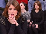 Missing home? A sombre Princess Eugenie fidgets through a New York basketball game as she sits alone