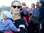 Elizabeth Berkley and Greg Lauren take their toddler to the Farmers Market and bump into Rachel Zoe's husband and son