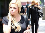 Who's the mystery man? Australian star Sophie Monk gets amorous in the street with an unknown blonde