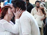 Married star Jason Momoa looks very friendly with mystery redhead at house party