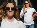 Pregnant Drew Barrymore covers her growing bump with inside-out Christmas sweatshirt at yoga class