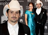 His biggest fan! Brad Paisley cheered on by wife Kimberly Williams-Paisley as he is honoured at Symphony Ball in Nashville