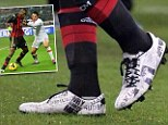 Why always him? Mario Balotelli wore custom boots that featured headlines from his career in AC Milan's match with Roma