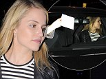 Can't sing your way out of that! Glee actress Dianna Agron is greeted with a parking ticket after a girls night out
