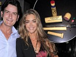 'I'm done being treated like a relative with a one-way ticket': Charlie Sheen chops up wedding gift after Denise Richards uninvites him to Christmas vacation