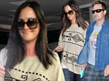 The big cover up! David Arquette's pregnant girlfriend Christina McLarty hides her baby bump underneath a poncho as she enjoys a day out with actor