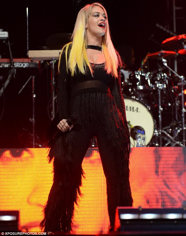 Having a ball: Rita was seen sporting her signature bright red lips for the performance at the festival