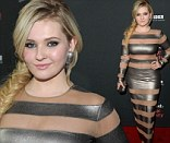 Is that age appropriate? Abigail Breslin donned a revealing form-fitted frock to the premiere of August: Osage County at Regal Cinemas L.A. Live on in Los Angeles, California on Monday