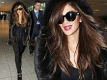 The party's over: Nicole Scherzinger covers up as she heads to airport to fly to Los Angeles for Christmas