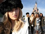 From Russia with love: Perrie Edwards wears a black faux-fur pillbox hat to Disneyland Paris with Little Mix