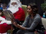 A special visit: First Lady Michelle Obama brings Christmas cheer to the Children's National Health System hospital in Washington on Monday with a readying of 'Twas the Night Before Christmas
