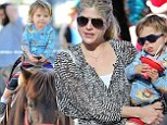 Indulging in horseplay! Selma Blair takes son Arthur for a pony ride and Santa visit at the farmers market
