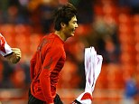 Delight: Ki Sung-Yong rips off his shirt after scoring the winner ion the 28th minute of extra time