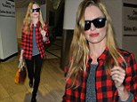 Super(woman) Returns: Picture perfect Kate Bosworth looks great after a night flight to Los Angeles