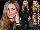 That's not your furry best! Lindsay Lohan dons a fluffy coat before removing it to reveal an unflattering black ensemble as she takes on the role of 'tech advisor'