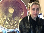 Make-up free Miley Cyrus dons outlandish Tom Ford fur coat after landing in freezing Washington, DC
