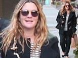 Hey sailor: Pregnant Drew Barrymore wears striped top under a duffel coat with a friend in LA