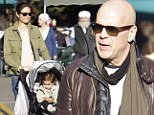 He's no pushy parent! Bruce Willis lets wife Emma Heming shove the baby stroller as they visit market