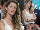 She still loves you! Gisele Bundchen patiently waits outside Tom Brady's locker room to console him after his football team loses game