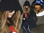 'Taking it really slow': Khloe Kardashian covers up in a hoodie for gym trip as 'romance with Matt Kemp gets cooking'