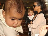 They're already BFFs! Baby North and cousin Penelope bond as their mothers Kim and Kourtney Kardashian grab lunch