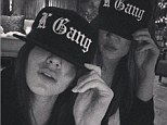 Gang culture: Kendall Jenner posted this picture of herself and sister Khloe Kardashian on Instagram on Tuesday