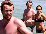 Simon Baker and his bikini-clad wife cool off with a dip in the ocean as they soak up the sun at Bondi Beach