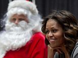Michelle Obama revealed what she is buying the President for Christmas (seen on Monday at a holiday reading at a D.C. children's hospital)