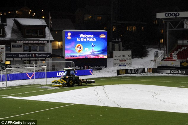 Almost there: The tractor gets to work on the penalty area ahead of kick-off
