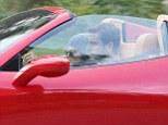 Scott Disick picks Kourtney Kardashian up in flashy new Ferrari as family sources slam reports the couple are living apart