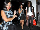 Date? Ashanti steps out with a  handsome companion