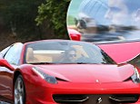 Scott Disick picks Kourtney Kardashian up in flashy new Ferrari as family sources slam reports the couple are living apart