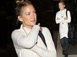 She's a natural: Kate Hudson shows off her flawless complexion as she goes makeup for another jet set trip