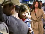 Home for the holidays! Nick and makeup free Vanessa Lachey dote over their growing mini me son Camden as they jet out for Christmas break