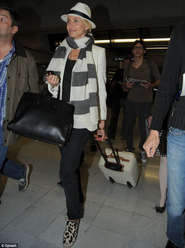 Feeling wild: The 40-year-old actress wore a pair of pony skin shoes on her feet for the flight