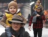 The best way to travel! Orlando Bloom carried his son Flynn on his shoulders after lunch in Manhattan on Tuesday