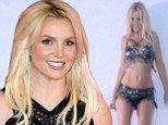 Britney Spears strips down to leather bra and skimpy shorts in behind the scenes still from her Work B**** music video