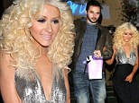 Christina Aguilera turns heads in plunging metallic and black dress for romantic dinner with boyfriend after The Voice finale
