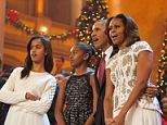 Mr Obama said that he is surrounded by 'opinionated, strong, tall women' (seen together at a Christmas event on Sunday)
