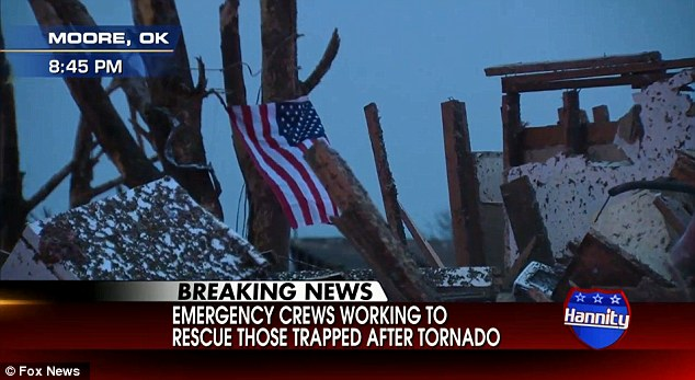 Sgt. Troy Gamble hung this flag from the ruins of his own home in Moore, Oklahoma in the aftermath of the tornado which devastated the entire community