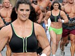 Danica Patrick like you've never seen her before! Racing driver displays bulky frame to film Super Bowl commercial... but it's just a muscle suit