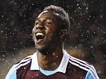 On the run: Maiga celebrates after sealing a place for West Ham in the last four of the Capital One Cup
