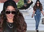 Walking on air! Vanessa Hudgens makes an unusual fashion statement in perspex sole shoes