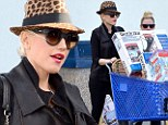 Gwen Stefani went all out as she splurged on a packed trolley of gifts at the Toys R Us store in Van Nuys on Tuesday.