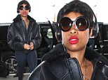 Grooving to the beat! Pixie-haired Jennifer Hudson cuts a sleek figure in leather jacket and leggings at LAX