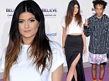 Clashing: Kylie Jenner, left, shined in a thigh-high-slit skirt, as Jade Smith, right, arrived in a bizarre outfit for the world premiere of Justin Bieber's Believe in Los Angeles, California on Wednesday